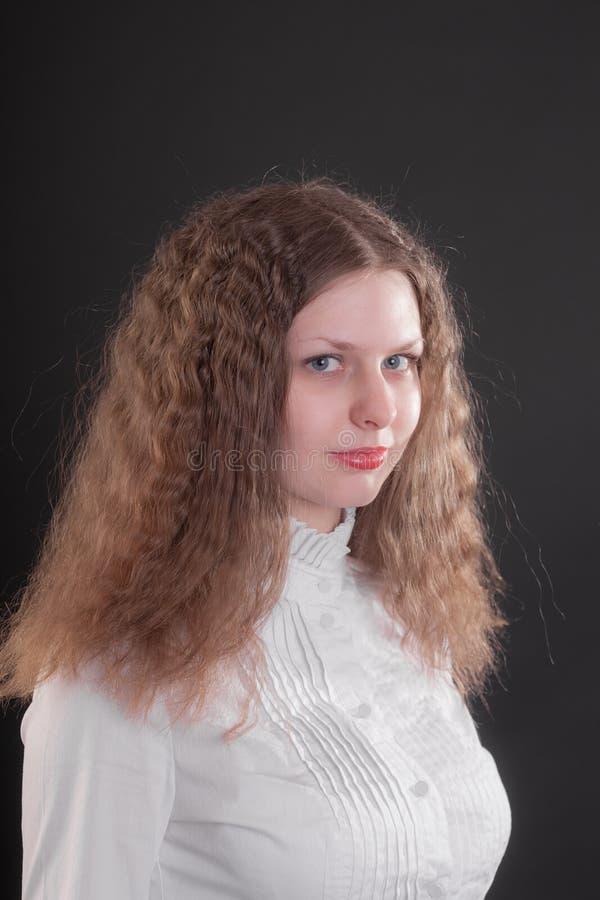 青少年长期女孩的头发 免版税库存照片