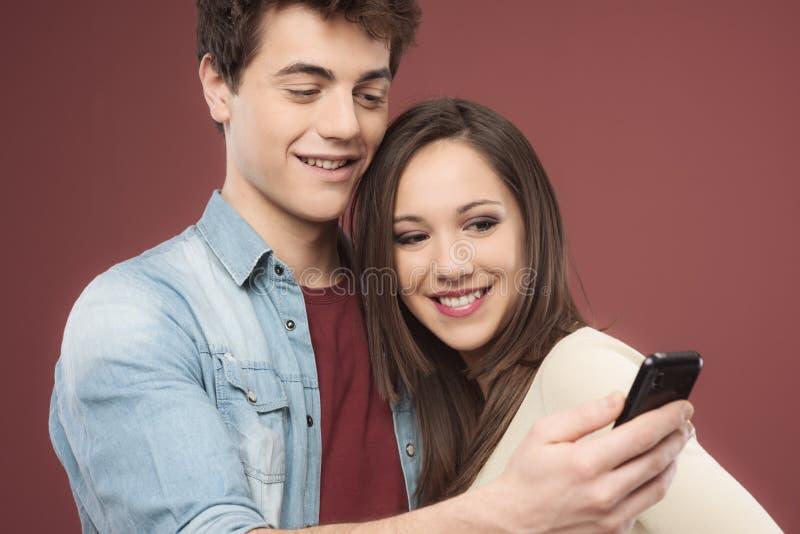 青少年加上智能手机 免版税库存照片