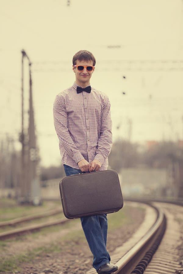 青少年在铁路 免版税图库摄影