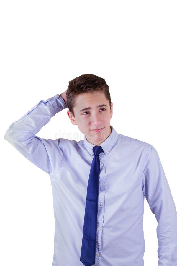 青少年男孩怀疑 查出在白色 免版税库存图片