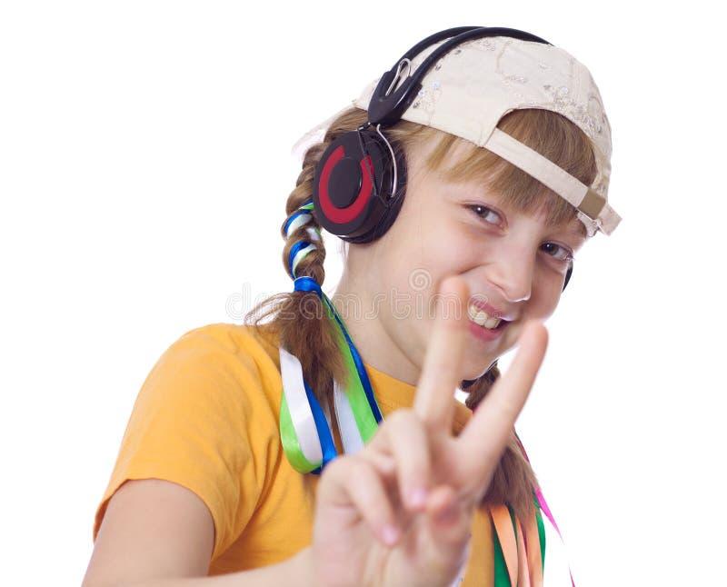 青年期女孩耳机 免版税图库摄影