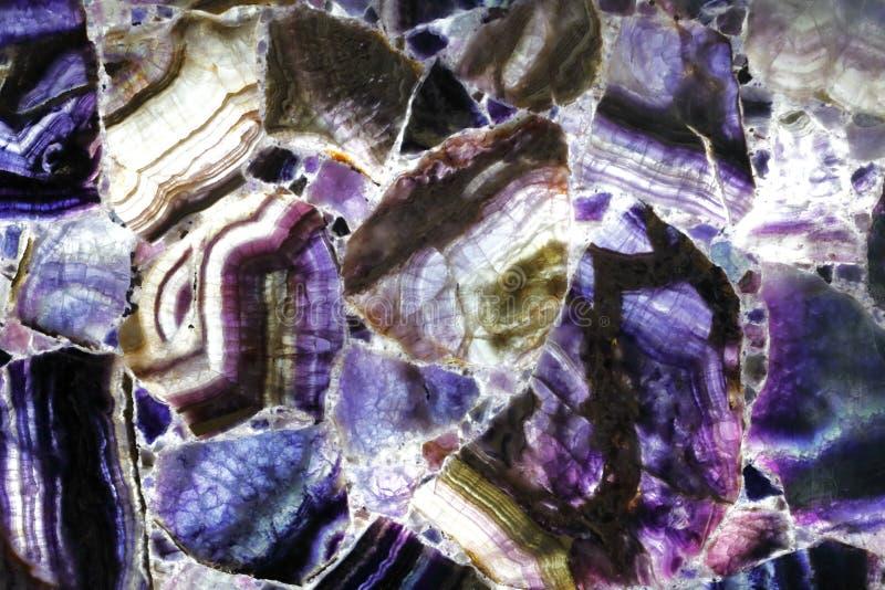 青紫罗兰色优越自然石材料 库存照片