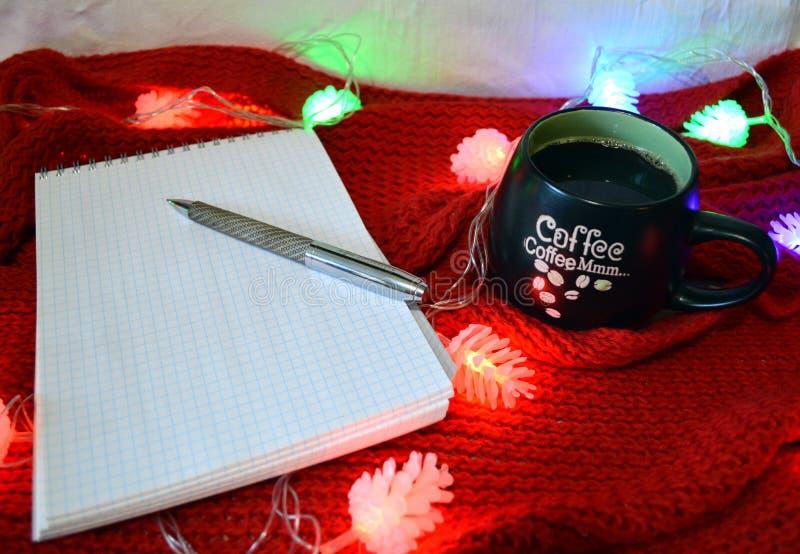 静物画用咖啡和笔记本在红色背景 图库摄影