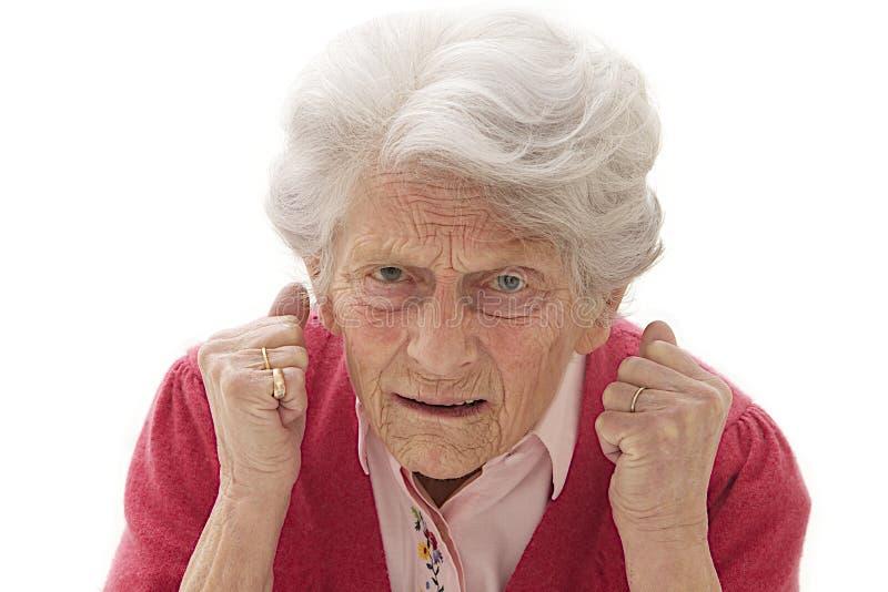 非常不快乐的资深妇女 免版税库存图片