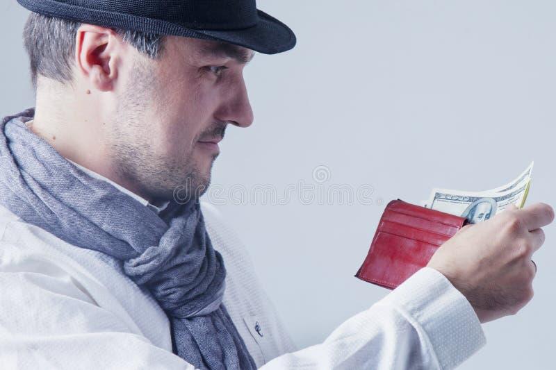 非常与金钱的愉快的商人在手中 成功,自由, fi 免版税库存照片