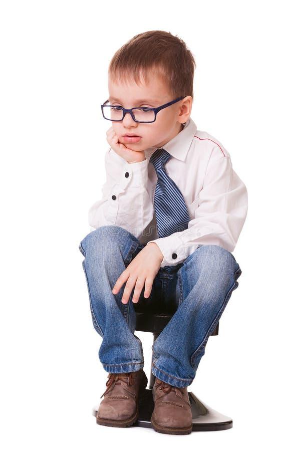 非常在白色的哀伤的聪明的孩子 库存图片