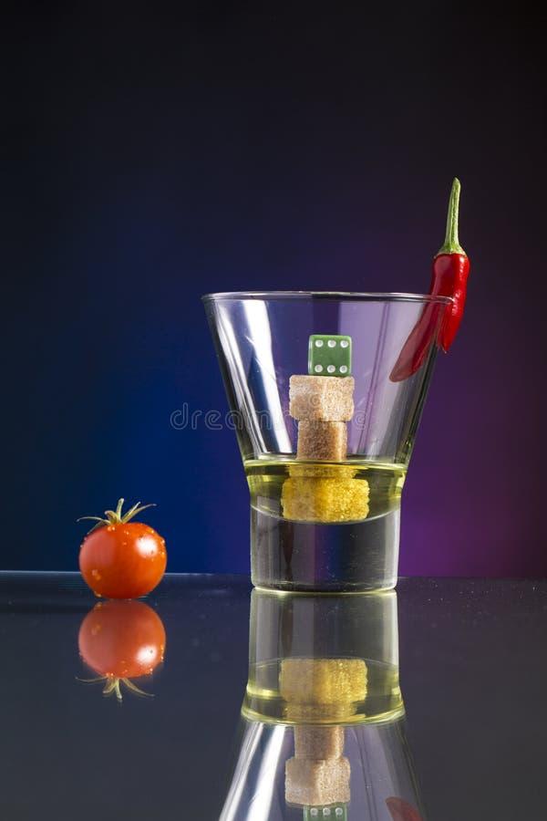 非常热和甜鸡尾酒用方糖和辣椒 图库摄影