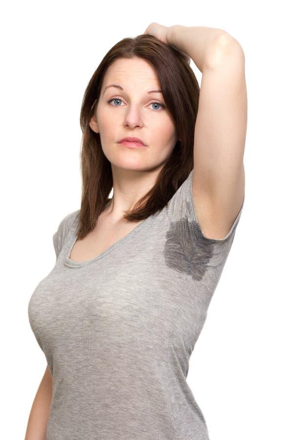 非常非常冒汗在腋窝下的妇女 免版税库存照片