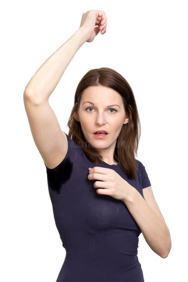 非常非常冒汗在腋窝之下的妇女 免版税库存图片
