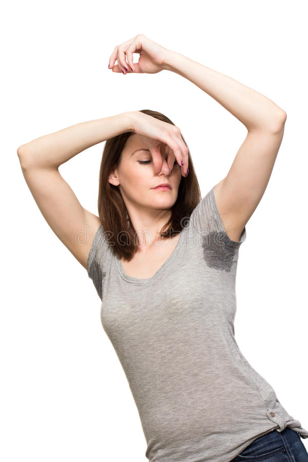 非常非常冒汗在腋窝之下的妇女 库存图片