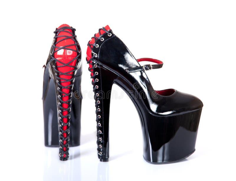 非常高跟的迷信平台鞋子 免版税库存照片