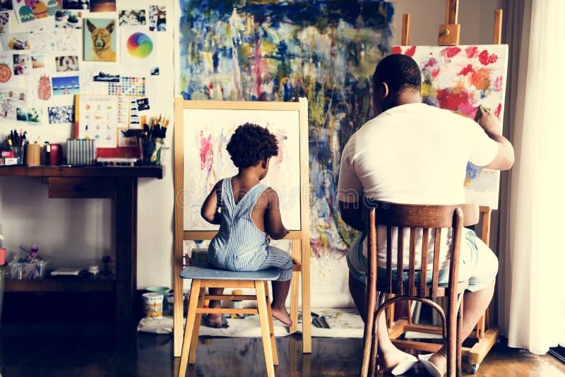 非洲父亲和儿子绘画艺术作品 免版税库存图片