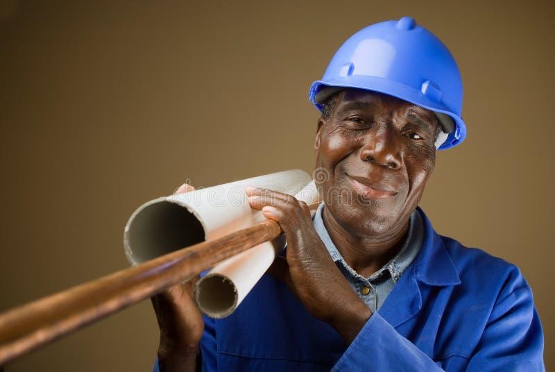 非洲管道工工作者 库存照片