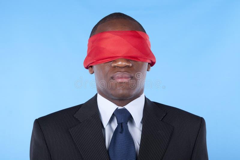 非洲蒙住眼睛的生意人 免版税库存照片