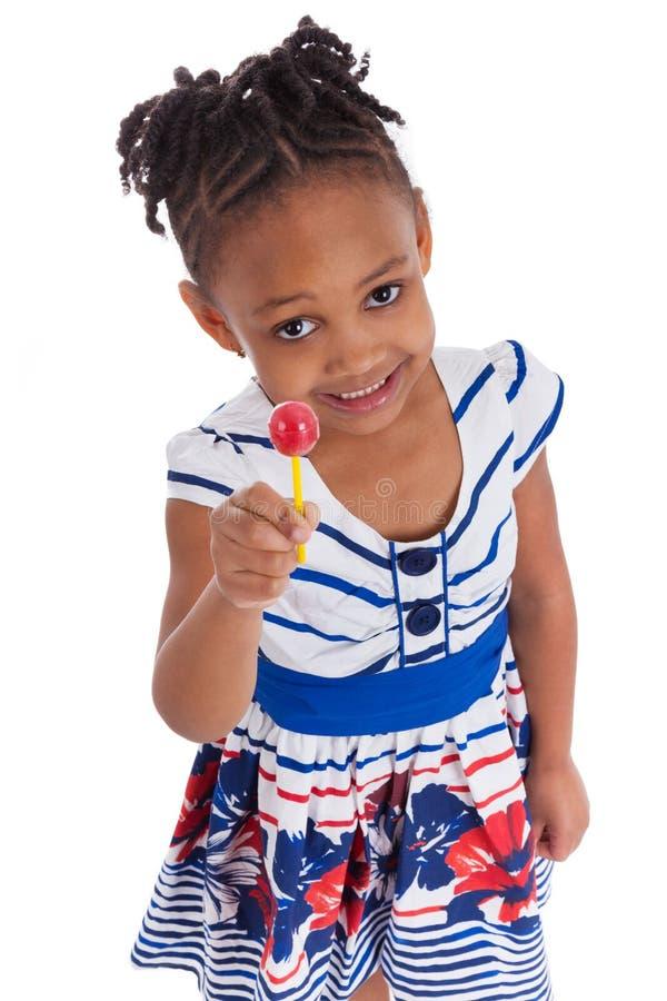 非洲裔美国人的女孩少许棒棒糖 库存照片