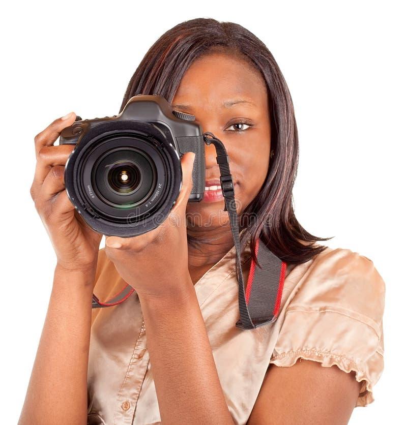 非洲裔美国人的女性摄影师射击您 免版税库存照片