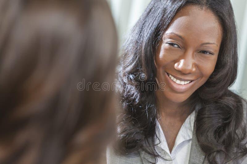 非洲裔美国人的妇女或女实业家在会议 图库摄影