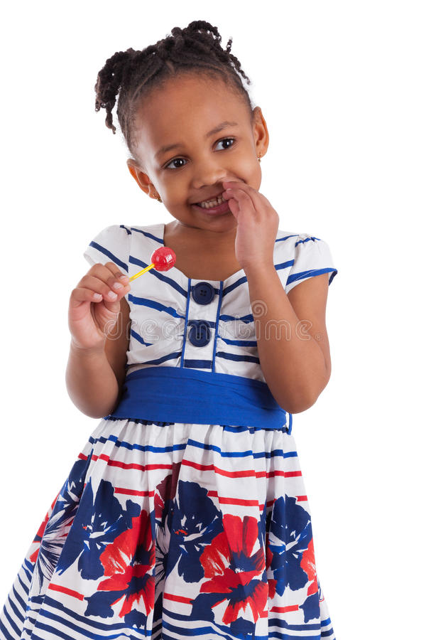 非洲裔美国人的逗人喜爱的女孩少许棒棒糖 库存照片