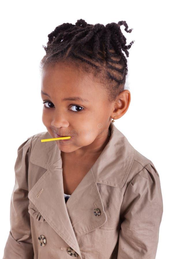 非洲裔美国人的逗人喜爱的女孩少许棒棒糖 库存图片