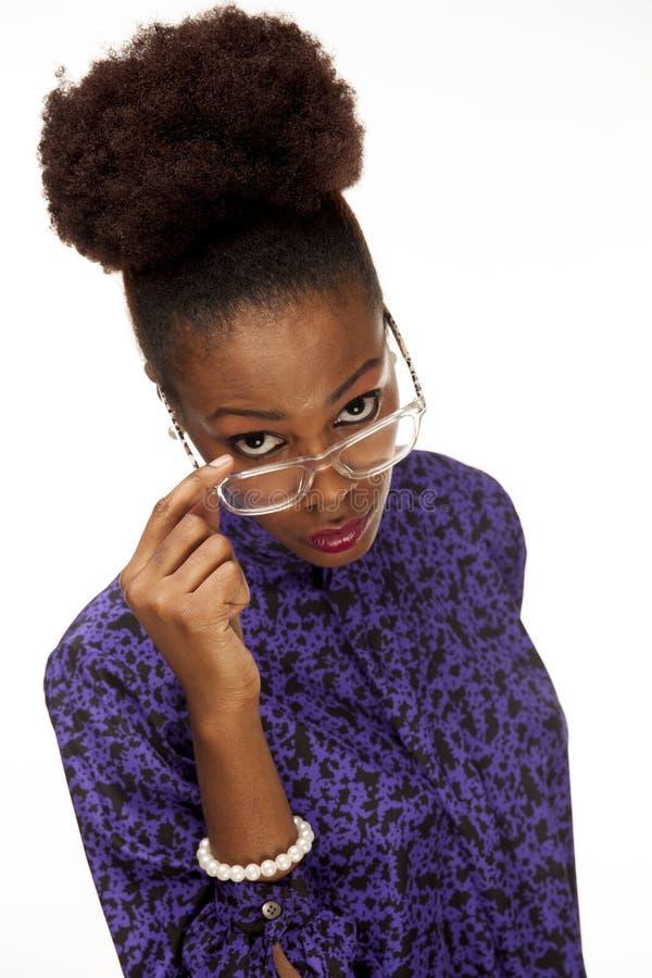 非裔美国人的妇女看在她的玻璃您 图库摄影
