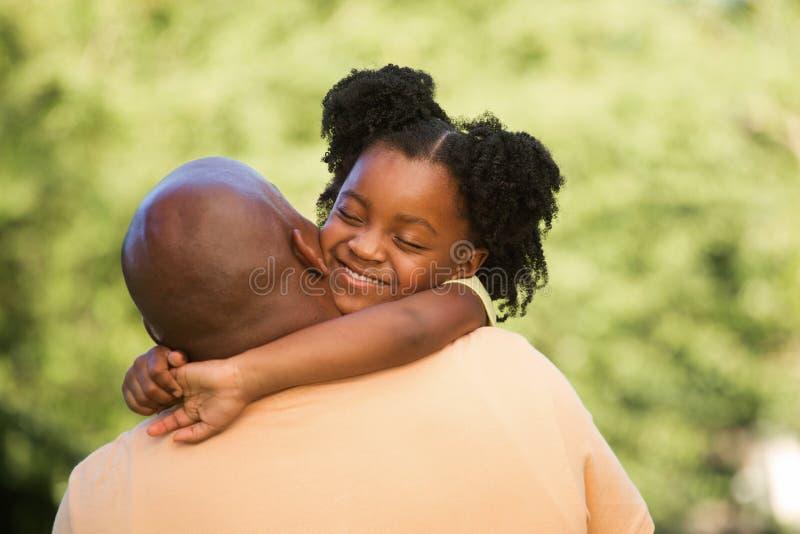 非裔美国人的父亲和他的女儿 图库摄影