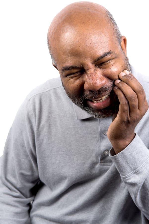 非裔美国男子牙痛触摸脸颊 牙痛老年人 白色背景 库存照片