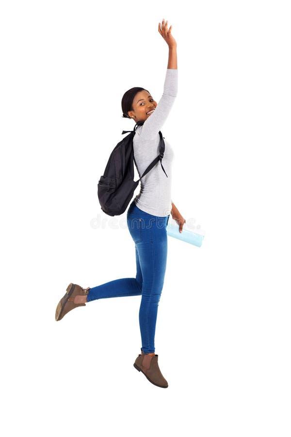 非洲大学生跳跃 免版税库存图片