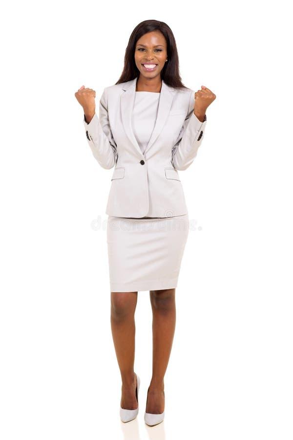 非洲女实业家挥动的拳头 免版税库存图片