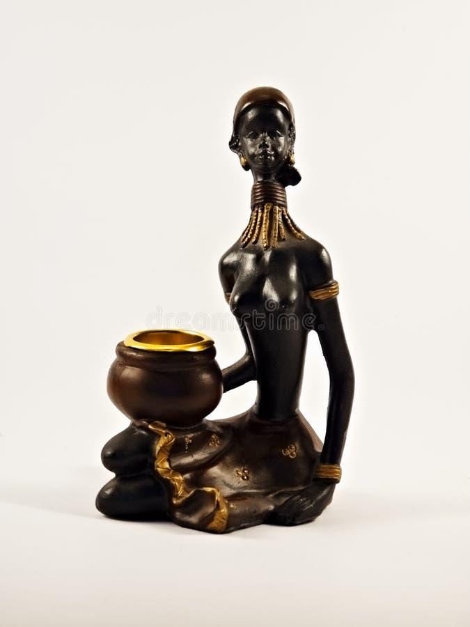 年轻非洲妇女小雕象  库存照片