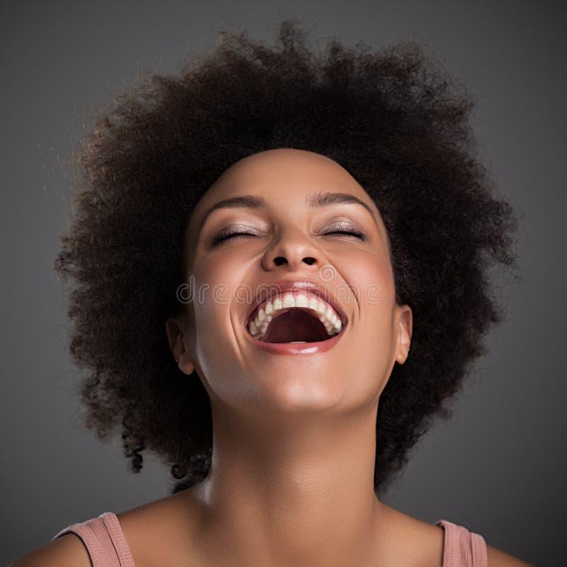 非洲妇女笑 免版税库存照片