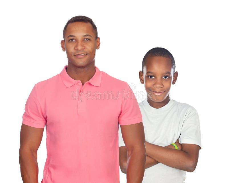非洲父亲和儿子被隔绝 免版税库存照片