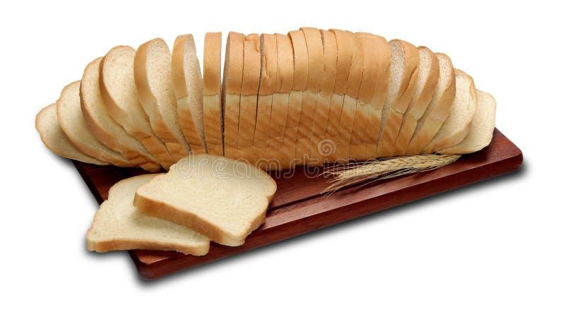 面包与认为在白色背景隔绝的裁减切片 免版税库存图片