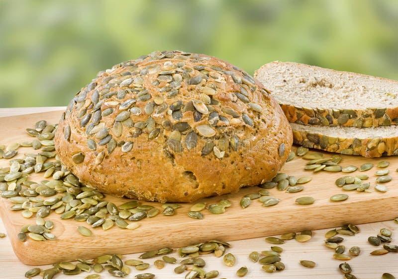 面包全麦的南瓜籽 免版税库存照片