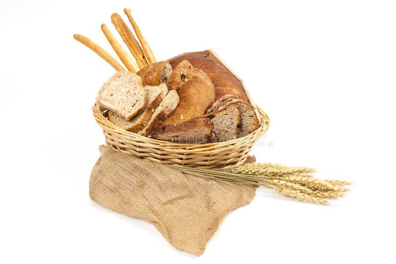 面包和谷物在whitebackground 免版税库存图片