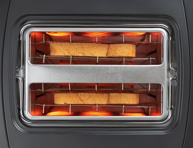 面包在多士炉顶视图,关闭敬酒了  库存图片