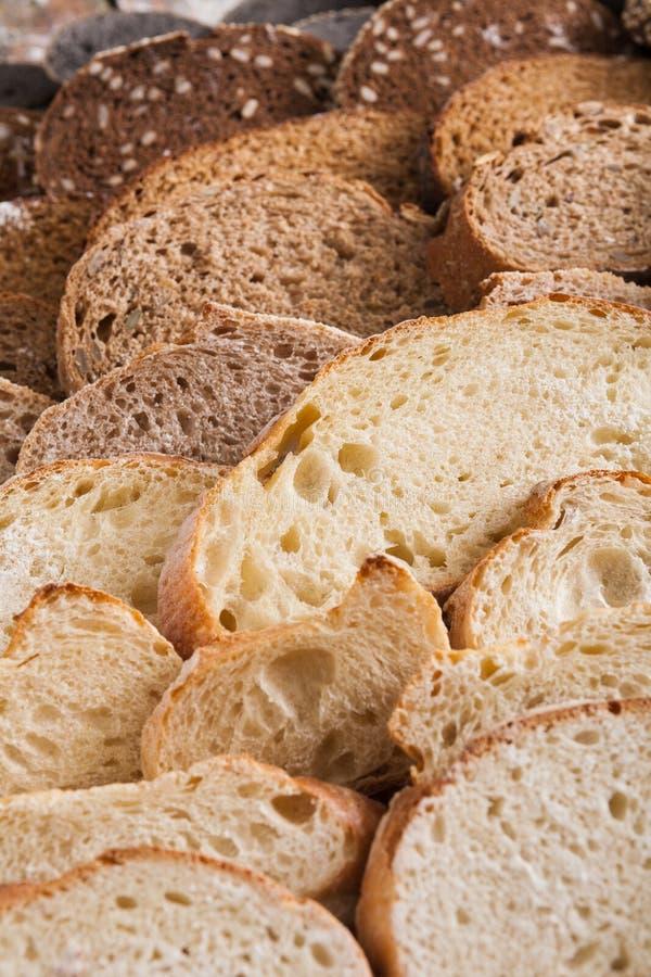 面包店概念 大量被切的面包背景 免版税库存图片