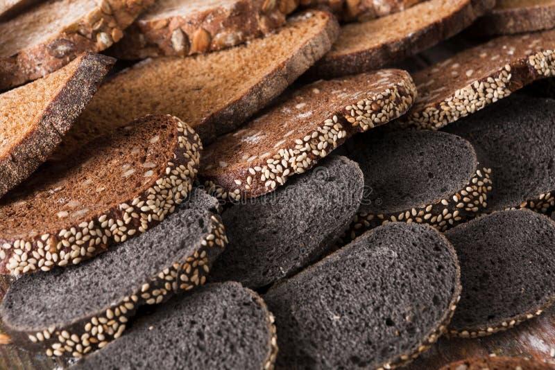 面包店概念 大量被切的面包背景 图库摄影