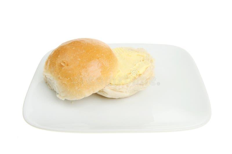 面包涂黄油的卷 免版税库存照片