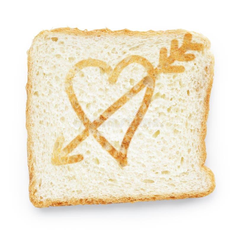 面包片与心脏和箭头的 免版税库存图片