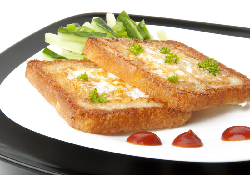 面包鸡蛋敬酒了白色 库存照片