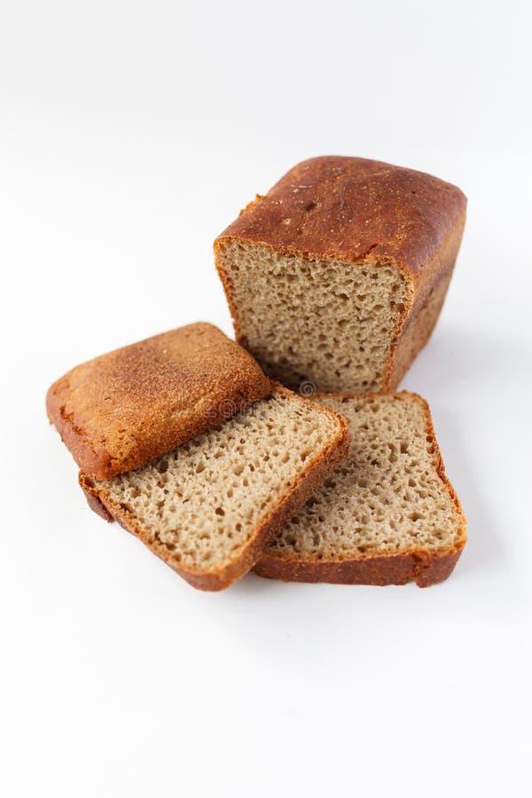 面包,面包店象,切了在白色背景隔绝的新鲜的麦子面包 免版税库存照片