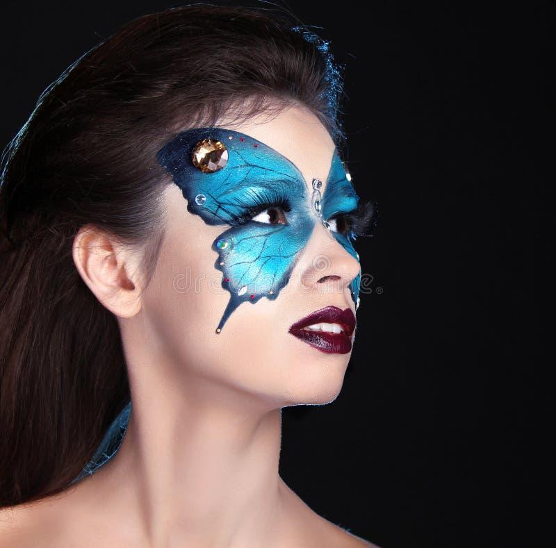 面孔艺术画象。时尚组成。在面孔的蝴蝶构成 库存照片