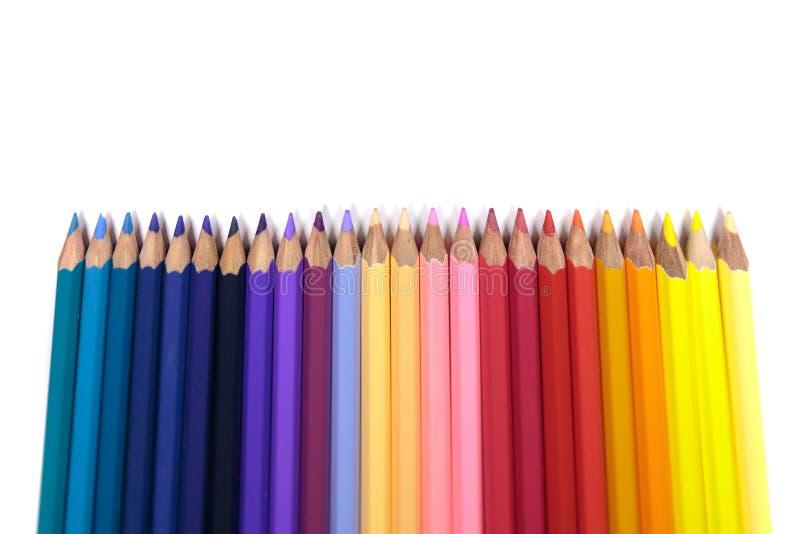 面对在纯净的白色背景的孩子的颜色铅笔 库存图片