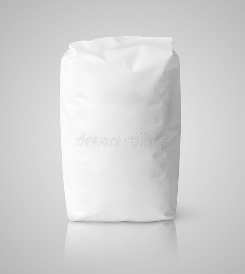 面粉白色白纸袋子包裹在灰色的 库存图片