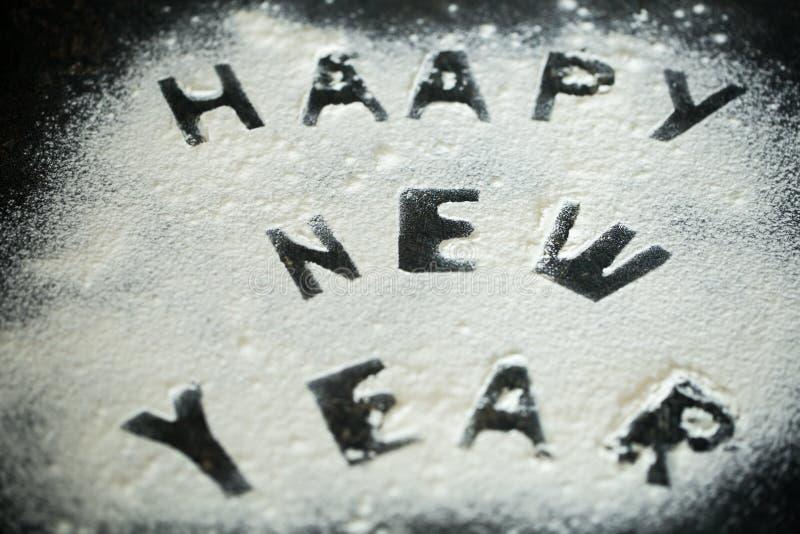 面粉的新年2017年题字在桌上的 库存图片