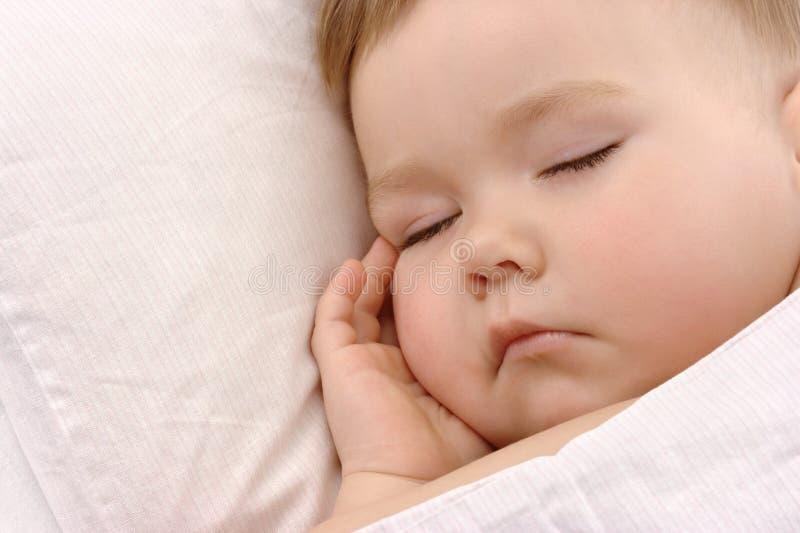 面颊儿童现有量休眠的他的下 免版税库存图片