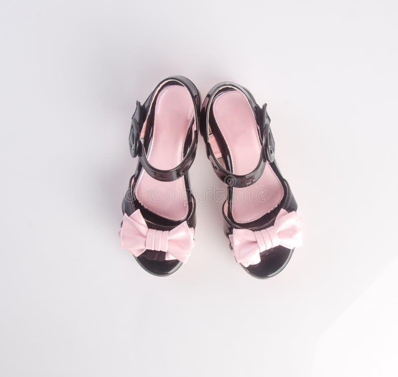 鞋子或美丽的小女孩鞋子在背景 图库摄影