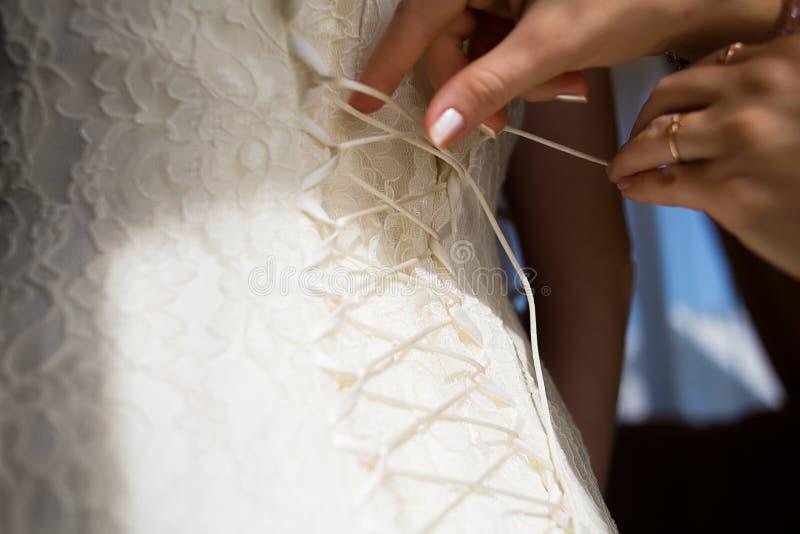 鞋带婚礼礼服束腰 库存照片