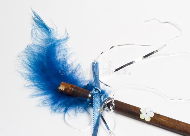 鞭子的蓝色接近的羽毛魔术 免版税图库摄影