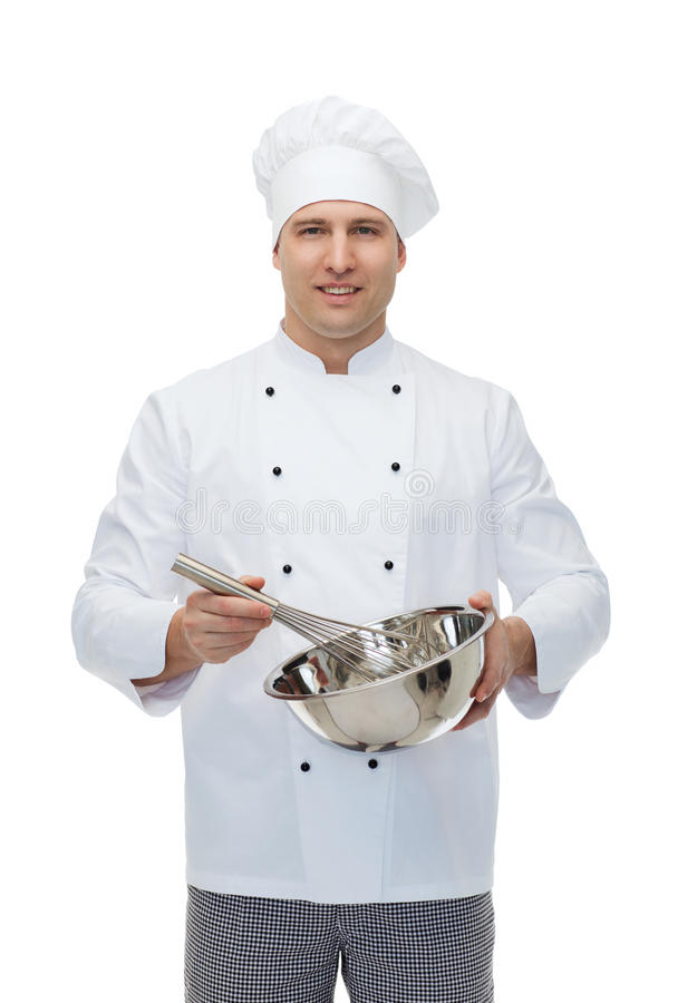 鞭打某事与的愉快的男性厨师厨师扫 库存图片